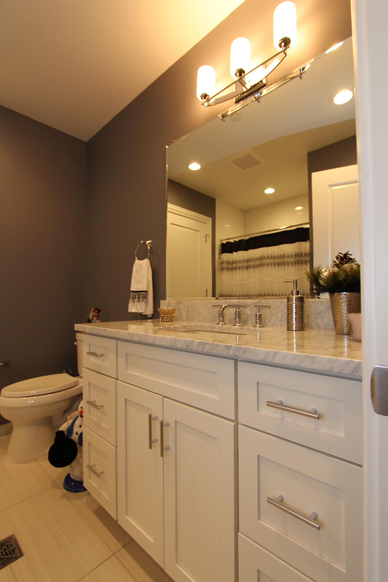 Bathroom Sink and Toilet | 9 East Main St | Uptown Bay City